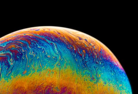 multicolored planet fluid painting